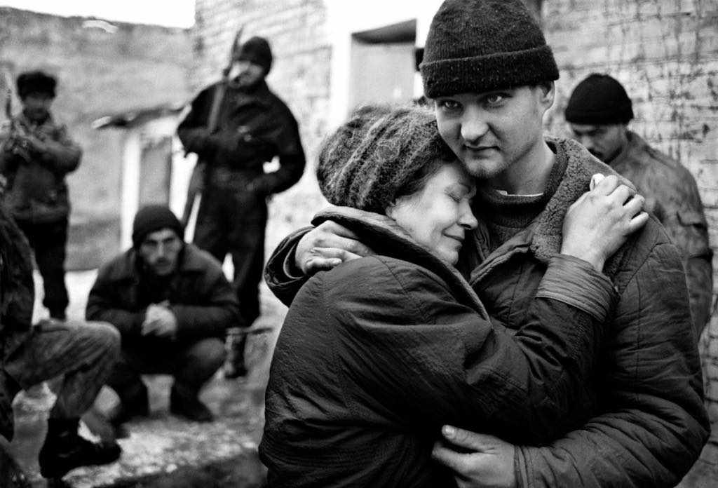 A Russian mother found the sun (soldier) in Chechen captivity. Shali town. Chechnya. Russia, 1995, February. Photo by Oleg Klimov