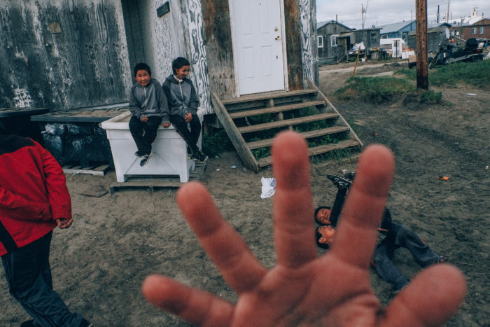 Children playing on a street of Shishmaref village, Alaska.